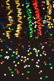 Colorful streamer on black paper background Stock Photography