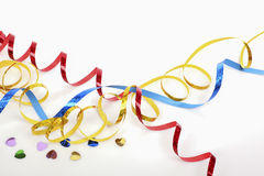Colorful streamers and confetti on white table close up Stock Photo