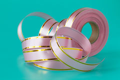 Colorful streamers ribbon tape on aquamarine background royalty free stock image