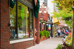 Colorful street. Saugatuck, MI - September 4, 2011: The many shops and galleries of Saugatuck draw Labor Day Weekend visitors to this charming Lake Michigan Royalty Free Stock Photos