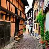 Colorful street in Alsace, France. Beautiful colorful street in the of the town of Eguisheim, Alsace, France Stock Images