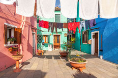 Colorful street in Burano, Venice, Italy Stock Photos