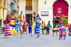 Colorful street dancers on stilts in Old Havana Royalty Free Stock Photography
