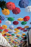 Umbrellas Street. Colorful street with many different colors umbrellas at sky Royalty Free Stock Photo