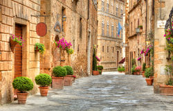 Colorful street in Pienza, Tuscany, Italy stock images