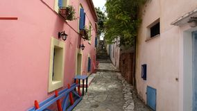 A colorful Street in the Port of Fiscardo in island Kefalonia, Greece. stock photos