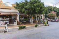 Matala street. Colorful street with  restaurants and taverns in Matala village , Crete , Greece , Europe . At sunset time Royalty Free Stock Photos