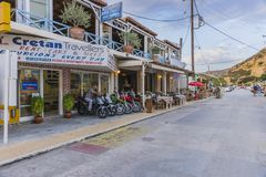 Matala street. Colorful street with  restaurants and taverns in Matala village , Crete , Greece , Europe . At sunset time Stock Photos