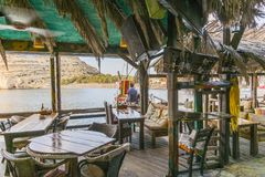 Matala street. Colorful street with  restaurants and taverns in Matala village , Crete , Greece , Europe . At sunset time . View from the tavern on the sea Royalty Free Stock Images