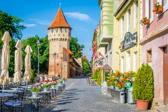 Colorful street in Sibiu in the morning, Transylvania region, Romania. July 2017, Sibiu, Romania royalty free stock photography