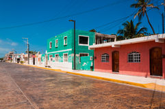 Colorful street in town of Progreso Yucatan Mexico. Progreso is a peaceful town in Mexico on Yucatan Peninsula. It's waters are not as clear as on the Caribbean Stock Photo