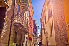 Colorful street of Verona in sun haze view. Vento region of Italy stock photos