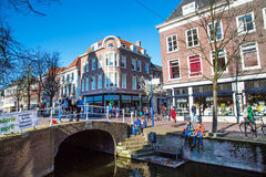 Colorful street view with houses, bridge, canal in Delft, Holland Royalty Free Stock Photos