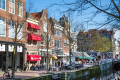 Colorful street view with houses and canal in Delft, Holland Stock Photos