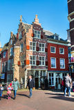 Colorful street view with houses and people in Delft, Holland Royalty Free Stock Photography