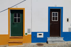 Colorful street village. Two doors of two houses in a typical street of the town of Mertola, Portugal Royalty Free Stock Images