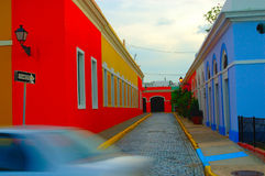 Colorful streets. Puerto Rico Old San Juan Street scene with passing car Royalty Free Stock Image