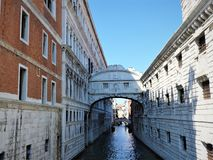 Colorful streets and canals of Venice on a clear day, Italy royalty free stock photography