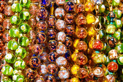 Colorful string of beads. Colorful strings of beads hanging on the street stand for sale in Venice Royalty Free Stock Images