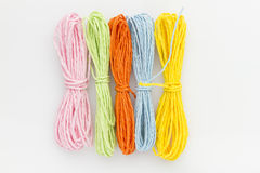 Colorful strings. Groups of colorful hanks of string isolated on white background Stock Images