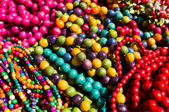 Colorful strings of semiprecious, wooden and glass. Bead necklaces displayed for sale on the Sorochintsy Fair. Selective focus Royalty Free Stock Photography