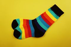 Colorful stripe socks on yellow background. Top View of colorful stripe socks on yellow backgroundn stock photography