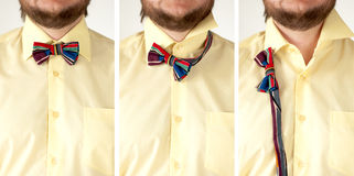 Colorful striped  bow tie with yellow shirt closeup. Royalty Free Stock Photo