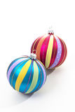 Colorful striped christmas spheres on white background Stock Images