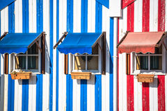 Colorful striped fishermen's houses in blue and red, Costa Nova, royalty free stock photography
