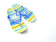 Colorful striped flip flops on white background stock photo