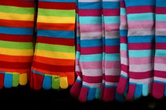 Colorful striped socks. Hanging for sale on a market Stock Photography