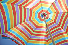 Colorful stripes beach umbrella Stock Photography