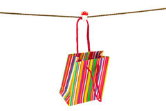 Colorful stripped shopping bag hanging on a rope Stock Photo