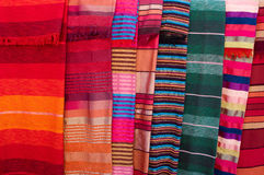 Colorful stripy bedcovers on market in Morocco Royalty Free Stock Photography