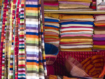 Colorful stuff. A lot of colorful scarf on the market place in Marrakesh, Morocco Stock Photos