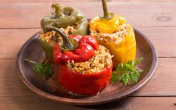 Colorful stuffed peppers. With rice , meat and parsley stock photo