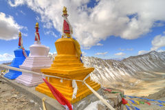Colorful stupas at hill top Royalty Free Stock Photos