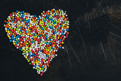Colorful Sugar Balls in the form of heart. Royalty Free Stock Image