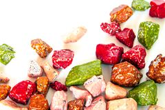 Sugar coated chocolate candy which has The shape imitate stone. Colorful of sugar coated chocolate candy which has The shape imitate stone royalty free stock photography