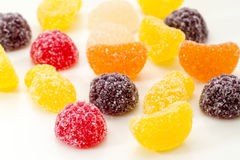 Colorful sugar coated fruity jelly sweets. Or jujubes with berries and citrus on a white background Royalty Free Stock Image