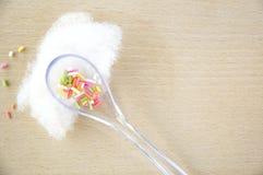 Colorful sugar in spoon Stock Photo