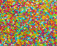 Colorful sugar sprinkles dots as a background , rainbow sprinkle Stock Photography