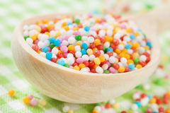 Colorful sugar sprinkles in wooden spoon Royalty Free Stock Photography