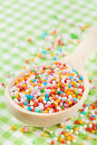Colorful sugar sprinkles in wooden spoon Royalty Free Stock Images