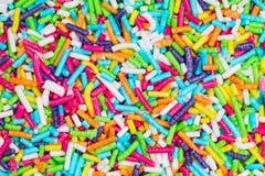 Colorful sugar sticks sprinkles Royalty Free Stock Photos