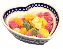 Colorful sugar sweets in a heart Royalty Free Stock Images