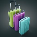 Colorful suitcases on dark background Stock Image
