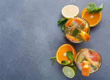 Colorful summer background with citrus drinks and fruits Stock Photo