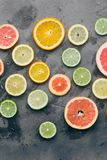 Colorful summer background fruits dark Lemon lime orange grapefr. Colorful summer background. Different citrus fruits on dark background close up. Lemon, lime royalty free stock image