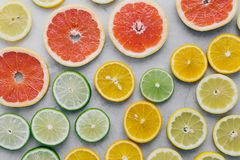Colorful summer background fruits white Lemon lime orange grapef. Colorful summer background. Different citrus fruits on white background close up. Lemon, lime stock photos